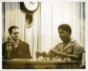Thumbnail of Bill Keith and Odetta, seated at a table, University of Massachusetts Amherst