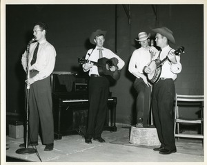 Thumbnail of Jim Rooney (guitar), Fritz Richmond (bass), and Bill Keith (banjo), performing             at the Whiting Milk Cerebral Palsy Square Dance