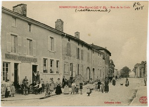 Thumbnail of Restaurant, Rue de la Croix Men and women gathered on the sidewalk and street in front of a restaurant