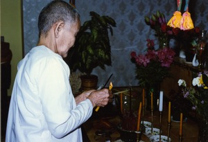 Thumbnail of Consecration of Buddhist statue at the Trairatanaram Temple Monk lighting incense