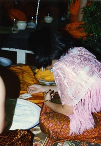 Thumbnail of Consecration of Buddhist statue at the Trairatanaram Temple Celebrants preparing rice