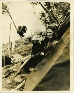 Thumbnail of A  Lapp mother with her baby, in the tent