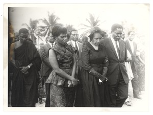 Thumbnail of Unidentified minister of the Ghanaian government escorting Shirley Graham Du Bois at the state funeral for W. E.         B. Du Bois