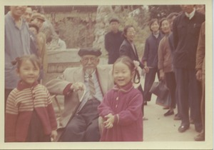 Thumbnail of W. E. B. Du Bois sitting with two unidentified children at the Summer Palace in             Beijing, China