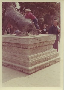 Thumbnail of Child climbing on a bronze qilin at the Summer Palace in Beijing, China