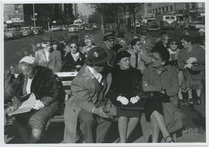 Thumbnail of People sitting on benches at the intersection of West 86th                 Street and Broadway in New York City