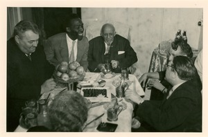 Thumbnail of W. E. B. Du Bois and others gathered around table in Soviet Union