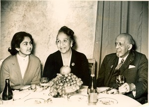 Thumbnail of W. E. B. Du Bois, Shirley Graham Du Bois, and unidentified woman at dinner