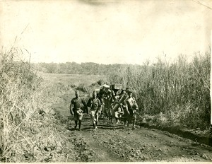 Thumbnail of Native porters on their way to Bare