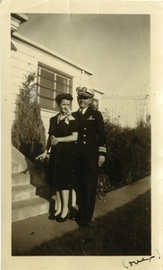 Thumbnail of Commander Stanley W. Lipsiki in naval uniform and wife Sigrid Johnson Lipski             outside a residence