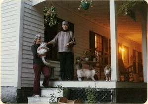 Thumbnail of Dorothy Johnson (left) and Doris Abramson on the porch of the home in New Salem, with some of their cats
