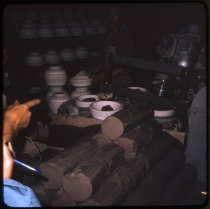 Thumbnail of Ceramics factory Woman painting a scene to be embroidered