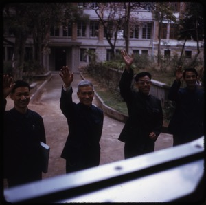 Thumbnail of Doctors at Canton Physicians from the medical school waving to the bus