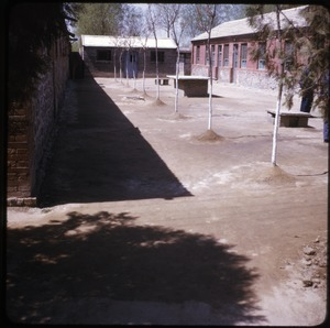 Thumbnail of Beijing District Cadre school: ping pong table Ping pong table in dusty courtyard