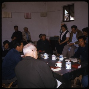 Thumbnail of Beijing District Cadre school Group of visitors and teachers seated around a table