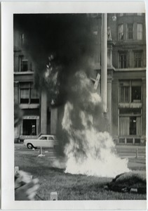 Thumbnail of The  files going up in their deserved flames Image of selective service files on fire in a public square