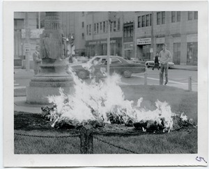 Thumbnail of The  fire lasted for 10 min. before the police even knew about it Image of draft records burning on the square