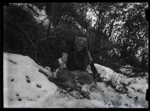 Thumbnail of Traditional medicine Healer laying person in snow
