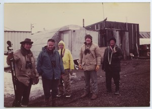 Thumbnail of Birders outside a quonset hut