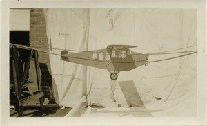 Thumbnail of Model airplane suspended on a pulley system