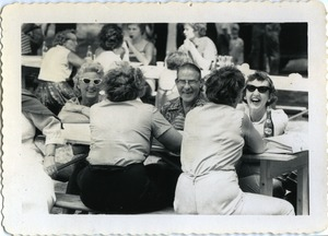 Thumbnail of Socializing at the picnic table, Pine Beach Rodney Hunt Company annual employee outing