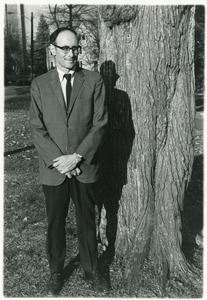 Thumbnail of Sidney Lipshires standing in front of a tree on the Manchester Community College             campus
