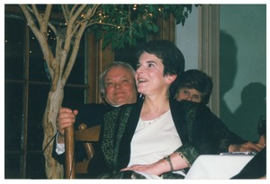 Thumbnail of Sidney Lipshires' friend, Jan Bendall, watching a speaker at a dinner event