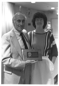 Thumbnail of Sidney Lipshires and daughter Lisa Lipshires at Cooley Dickinson Hospital, with             plaque honoring of David Lipshires
