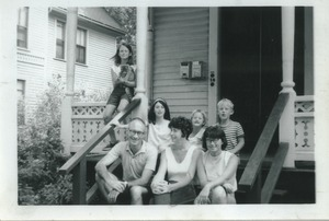 Thumbnail of Sidney and Joann Lipshires (center, bottom) on porch with family