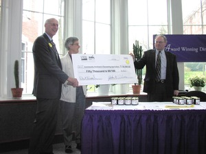 Thumbnail of Congressman John W. Olver presenting USDA check to Community Involved in Sustaining Agriculture         (CISA)