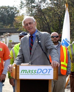 Thumbnail of Congressman John W. Olver at the podium, speaking at a MassDOT event