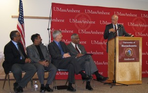 Thumbnail of Congressman John W. Olver at the podium at UMass Amherst Seated to left Olver, nearest, is interim UMass Amherst Chancellor Thomas W. Cole