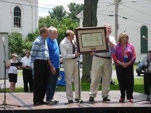 Thumbnail of 250th anniversary celebrations, Belchertown, Mass.             Mass. State Senator Stan Rosenberg (center) on the platform, presenting an awards