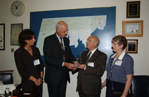 Thumbnail of Congressman John W. Olver presenting Outstanding Older Worker award to Robert             Grenier at Experience Works Left to right: Sharon Zimmerman, John Olver, Robert Grenier, and Helene             Grenier
