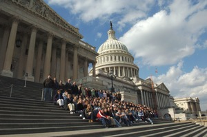 Thumbnail of Congressman John W. Olver (far right) with visiting group, posed on the steps of  the United States Capitol building