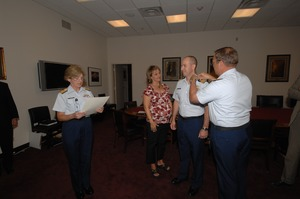 Thumbnail of Commander Mark Fedor (center), US Coast Guard, being sworn in as Special Detailee             to House Appropriations Committee