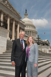 Thumbnail of Congressman John W. Olver (center) with unidentified woman, posed on the steps of  the United States Capitol building