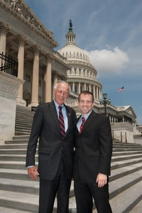 Thumbnail of Congressman John W. Olver (center) with unidentified man, posed on the steps of  the United States Capitol building