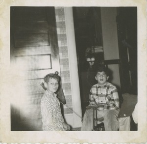 Thumbnail of Paul Kahn on tricycle, inside with brother Joel