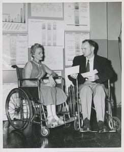 Thumbnail of Woman and man in wheelchairs in conversation at an administrators training group