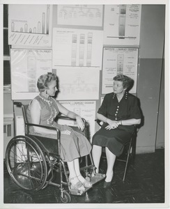 Thumbnail of Two women, one in a wheelchair, in conversation at an administrators training group
