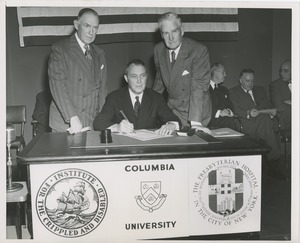 Thumbnail of Joseph Campbell, treasurer at Columbia University, signing affiliation agreement