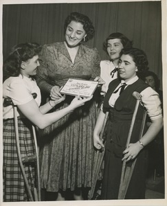Thumbnail of Three young women presenting Kay Armen with a certificate naming her an honorary member of club can do