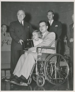Thumbnail of President Harry S. Truman handing a plaque to Nils S. Josefson