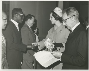 Thumbnail of Princess Benedikte of Denmark shaking hands with an unidentified man during her visit to an ICD facility