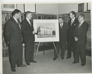 Thumbnail of Norman Salatini, Willis C. Gorthy, Sidney Heyman, officer William Morianty and an unidentified man observing prospective building plans