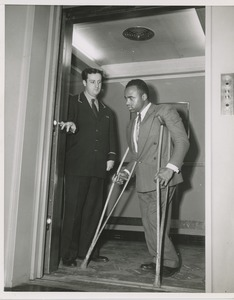 Thumbnail of Elevator operator and man on crutches