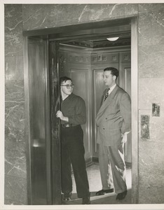 Thumbnail of Two unidentified men operating elevator