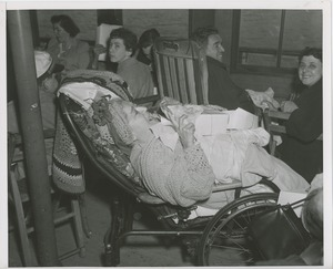 Thumbnail of Woman in reclining wheelchair