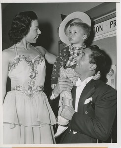 Thumbnail of Jimmy Valentine and his partner, Rita, with young patient at Halloween party